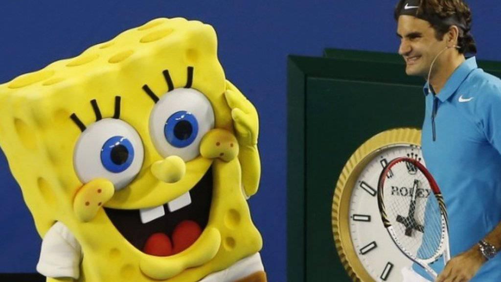 Spongebob - hier mit Roger Federer auf dem Tennis Court - kommt bald singend auf die Bühne. David Bowie, Cindy Lauper und Aerosmith komponieren für ihn (Archiv)