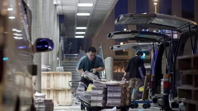 Auslieferung von Zeitungen in Hong Kong (Symbolbild)