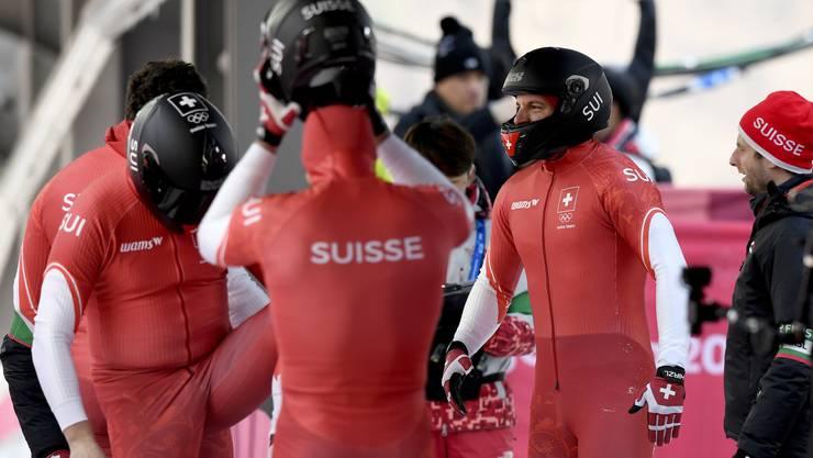 Knapp an der Medaille vorbei: Rico Peter, Thomas Amrhein, Simon Friedli amd Michael Kuonen nach ihrem Viererbob-Einsatz