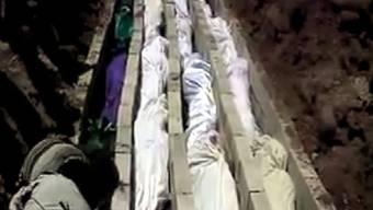 Grab mit Opfern des Massakers in Hula