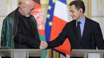 Hamid Karsai trifft Nicolas Sarkozy (rechts) in Paris