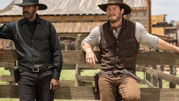 """Chris Pratt (r) und Denzel Washington spielen Hauptrollen im Western """"The Magnificent Seven"""" (Archiv)"""