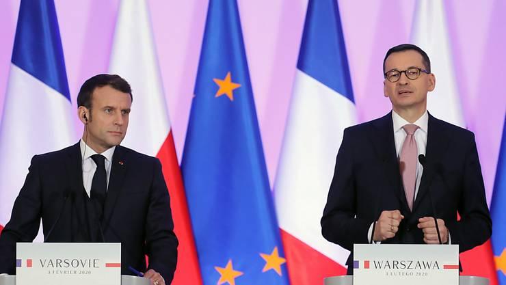 Frankreichs Präsident Emmanuel Macron wurde am Montag in Warschau von Polens Regierungschef Mateusz Morawiecki empfangen. Die beiden Länder sind sich laut Morawiecki näher als es scheint.