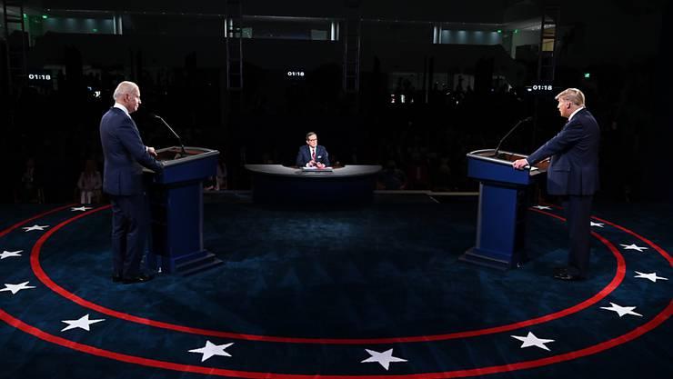 ARCHIV - Die für kommende Woche geplante zweite TV-Debatte von Donald Trump und Joe Biden zur US-Präsidentenwahl ist offiziell abgesagt worden. Foto: Olivier Douliery/Pool AFP/AP/dpa