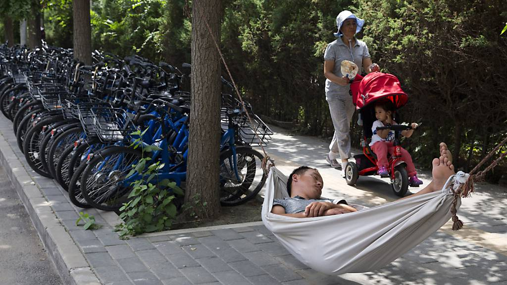 Chinas Führung alarmiert: Junge Chinesen wollen «flachliegen»