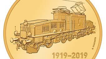 """Die Schweizer Elektrolokomotiven mit dem Übernahmen """"Krokodil"""" werden anlässlich ihres 100-Jahr-Jubiläums mit einer goldenen Sondermünze geehrt."""
