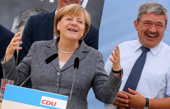 Am Tag vor der Wahl: Kanzlerin Angela Merkel mit CDU-Spitzenkandidat Lorenz Caffier bei einer Wahlkampfveranstaltung in Bad Doberan.