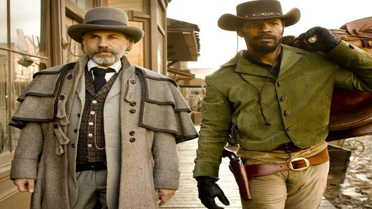 Kopfgeldjäger King Schultz (C. Waltz) macht sich die Schusswaffen-Talente von Django (Jamie Foxx) zunutze. HO