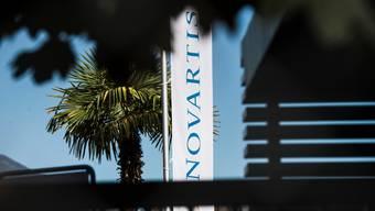 Konzerne wie Novartis dürften unter die neue Regelung fallen. Sie sollen künftig im Ausland mehr Steuern abliefern - und dafür weniger in der Schweiz.