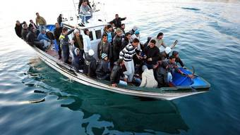 Nicht alle überleben: Flüchtlinge bei der Ankunft auf Lampedusa (Symbolbild)