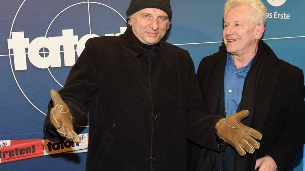 Udo Wachtveitl (l) and Miroslav Nemec sind zufriedene Fernsehkommissare und möchten das auch bleiben (Archiv)