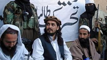 Mehsud (Mitte l.) war einer der meistgesuchten Männer Pakistans