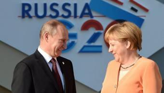 Putin und Merkel vor der ersten Session des G20-Gipfels