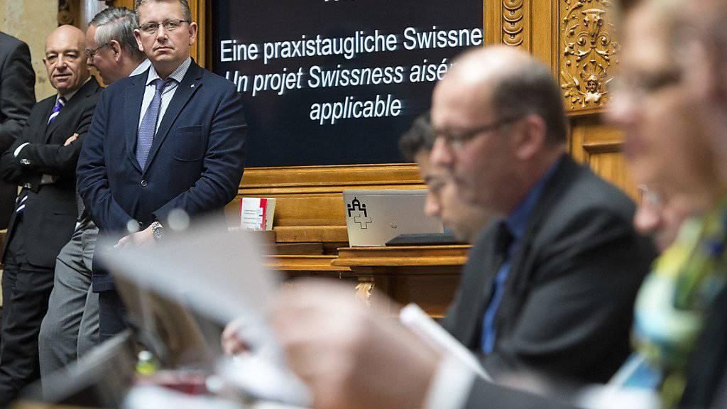 Nationalräte verfolgen die Swissness-Debatte.