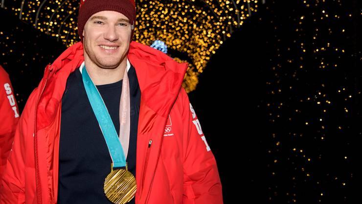 Dario Cologna mit seiner vierten Olympiamedaille
