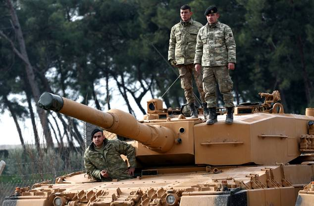 epa06459996 Turkish soldiers prepare their tanks near the Syrian-Turkish border, at Reyhanli district in Hatay, Turkey, 21 January 2018. Reports state that the Turkish army is on an operation (named 'Operation Olive Branch') in Syria's northern regions against the Kurdish Popular Protection Units (YPG) forces which control the city of Afrin. According to YPG media channels, bombings by the Turkish military killed at least 10 people earlier on the same day. Turkey classifies the YPG as a terrorist organization. EPA/SEDAT SUNA