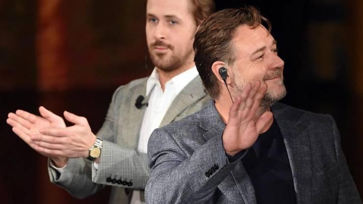 """Ryan Gosling (l) und Russel Crowe, die Hauptdarsteller im Film """"The Nice Guys"""", haben zurzeit Grund genug, sich Beifall zu klatschen (Archiv)"""