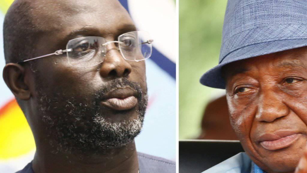 Sehr ungleiche Rivalen streiten sich um das liberianische Präsidentenamt: Der frühere Fussballstar George Weah (links) und der bisherige Vizepräsident und Vertreter der Regierungspartei UP, Joseph Boakai.