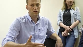Der russische Oppositionelle Alexej Nawalny bei seiner Anhörung vor Gericht in Moskau: Der Aufruf zu Protesten im ganzen Land bringt dem Kreml-Kritiker 30 Tage Haft ein.