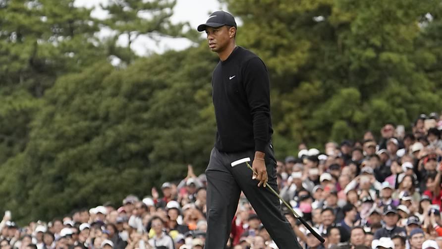 Auch im fernen Japan schart Tiger Woods Tausende von Fans um sich