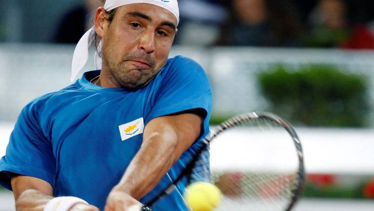 Marcos Baghdatis of Cyprus returns the ball to David Ferrer of Spain during their Madrid Open tennis match May 12, 2010. REUTERS/Andrea Comas (SPAIN - Tags: SPORT TENNIS)