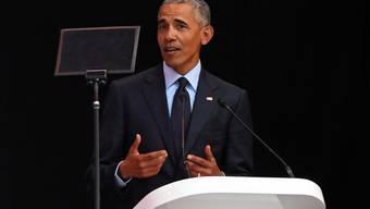 Der ehemalige US-Präsident Barack Obama ruft in Johannesburg zur Fortsetzung von Nerlson Mandelas Kampf gegen die Diskriminierung auf.