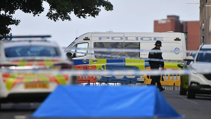 In Birmingham hat die Polizei den Tatort weitläufig abgesperrt. Foto: Jacob King/PA Wire/dpa