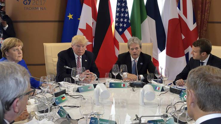 G7 leaders from left, German Chancellor Angela Merkel, U.S. President Donald Trump, Italian premier Paolo Gentiloni and French President Emmanuel Macron sit during the round table in Taormina, Italy, Friday, May 26, 2017. Leaders of the G7 meet Friday and Saturday, including newcomers Emmanuel Macron of France and Theresa May of Britain in an effort to forge a new dynamic after a year of global political turmoil amid a rise in nationalism. (Flavio Lo Scalzo/ANSA via AP)