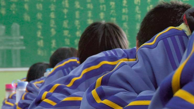 Schreckbild chinesische Schule: Doch für Kritiker unseres Bildungssystems werden Kinder auch an unseren Schulen «dressiert».