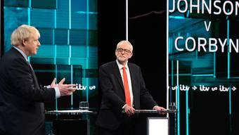 Die erste TV-Debatte vor der britischen Parlamentswahl war ein offener Schlagabtausch zwischen Premierminister Boris Johnson (links) und Oppositionsführer Jeremy Corbyn.