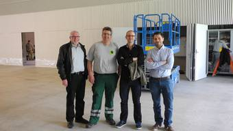 Stadtammann Rudolf Lüscher, René Leuenberger, Präsident der Baukommission der Stadthalle, Architekt Adrian Kloter und Bauleiter Davide Zuccarello freuen sich auf die Eröffnung der Stadthalle