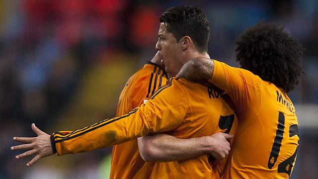 Cristiano Ronaldo (m.) schoss Real zum Sieg gegen Malaga