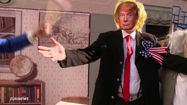 Trump zwischen kunterbunten Figuren an der Fasnacht