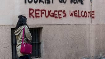 Massentourismus nicht willkommen: Die Botschaft an einer Hauswand in der Innenstadt von Palma de Mallorca spricht eine deutliche Sprache (Aufnahme vom April 2016).