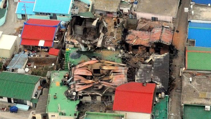 Zerstörte Häuser nach dem nordkoreanischen Granatenbeschuss auf der Insel Yeonpyeong.