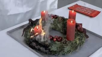 Brennender Adventskranz Symbolbild
