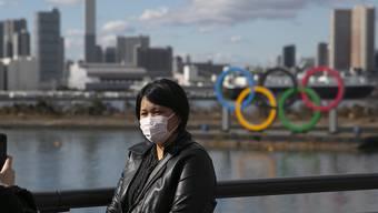 Schutzmaske und olympische Ringe: Tokio bangt um die Olympischen Spiele