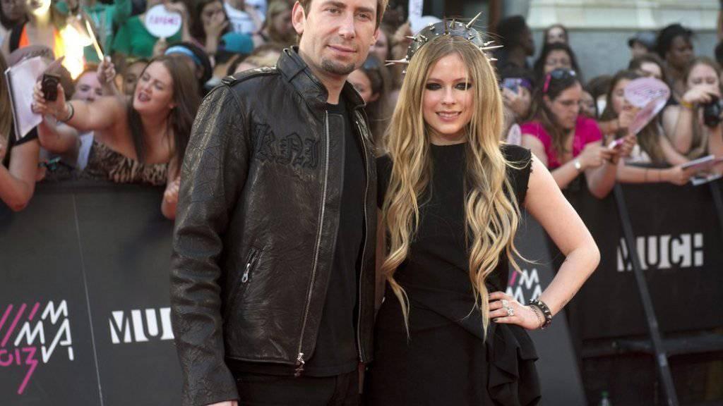 Chad Kroeger (l) und Avril Lavigne 2013, im Jahr ihrer Heirat (Archiv)
