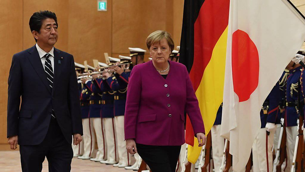 Haben die gleiche Marschrichtung: Die deutsche Kanzlerin Angela Merkel und der japanische Premierminister Shinzo Abe.