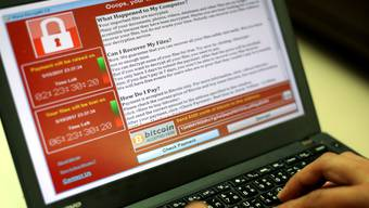 epa05960674 A programer shows a sample of a ransomware cyberattack on a laptop in Taipei, Taiwan, 13 May, 2017. According to news reports, a 'WannaCry' ransomware cyber attack hits thousands of computers in 99 countries encrypting files from affected computer units and demanding 300 US dollars through bitcoin to decrypt the files. EPA/RITCHIE B. TONGO