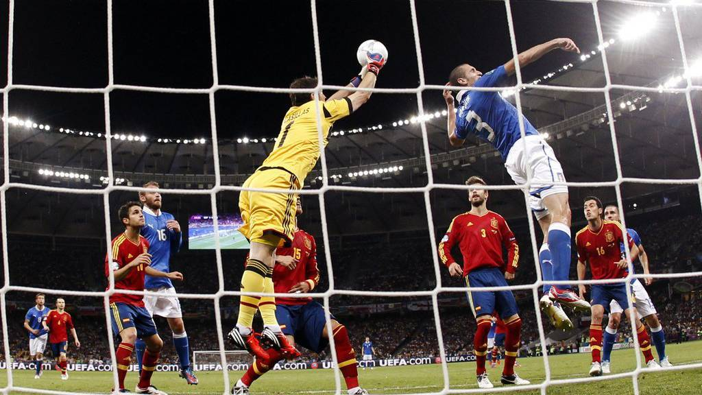 Spain goalkeeper Iker Casillas punches the ball during the Euro 2012 soccer championship final against Italy in Kiev, Ukraine, Sunday, July 1, 2012. (AP Photo/Matthias Schrader)