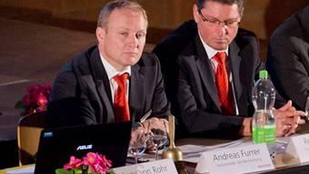 Bankleiter Andreas Furrer (l.)