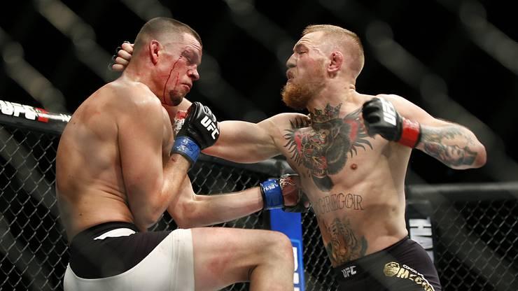 Conor McGregor (rechts) kassiert mindestens 100 Millionen Dollar