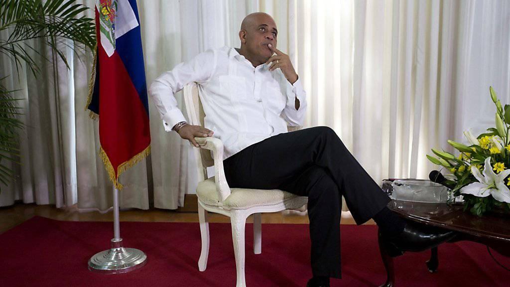 Der heutige Präsident Haitis, Michel Martelly: UNO-Generalsekretär Ban Ki Moon ruft die Kontrahenten in Haiti zur Zusammenarbeit auf.
