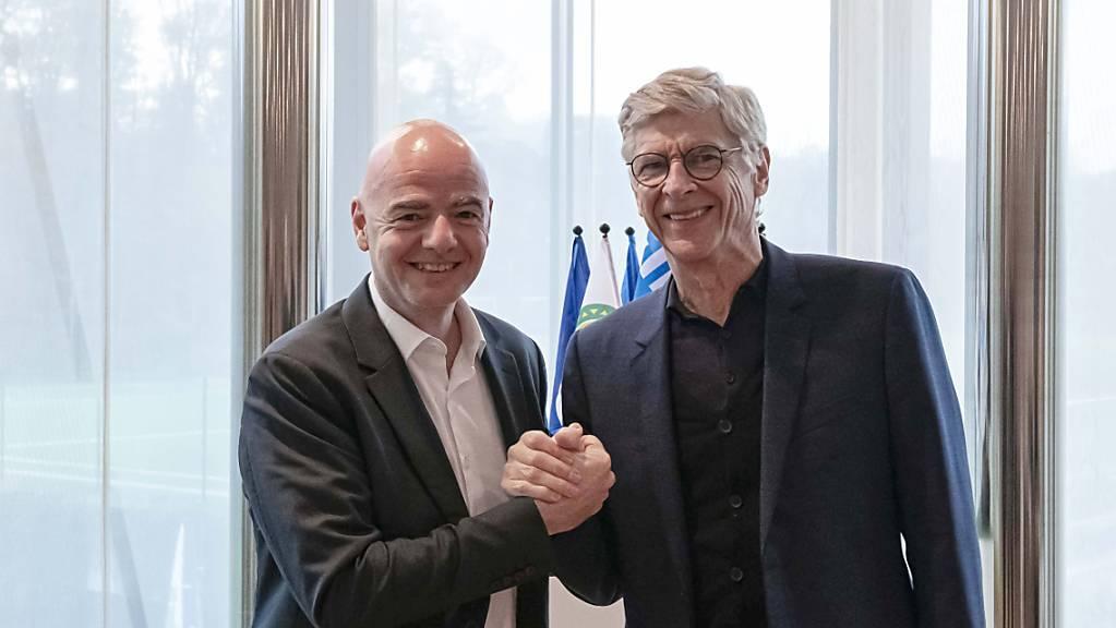 Halten an ihren Plänen für eine WM alle zwei Jahre fest: FIFA-Berater Arsène Wenger (re.) und Präsident Gianni Infantino