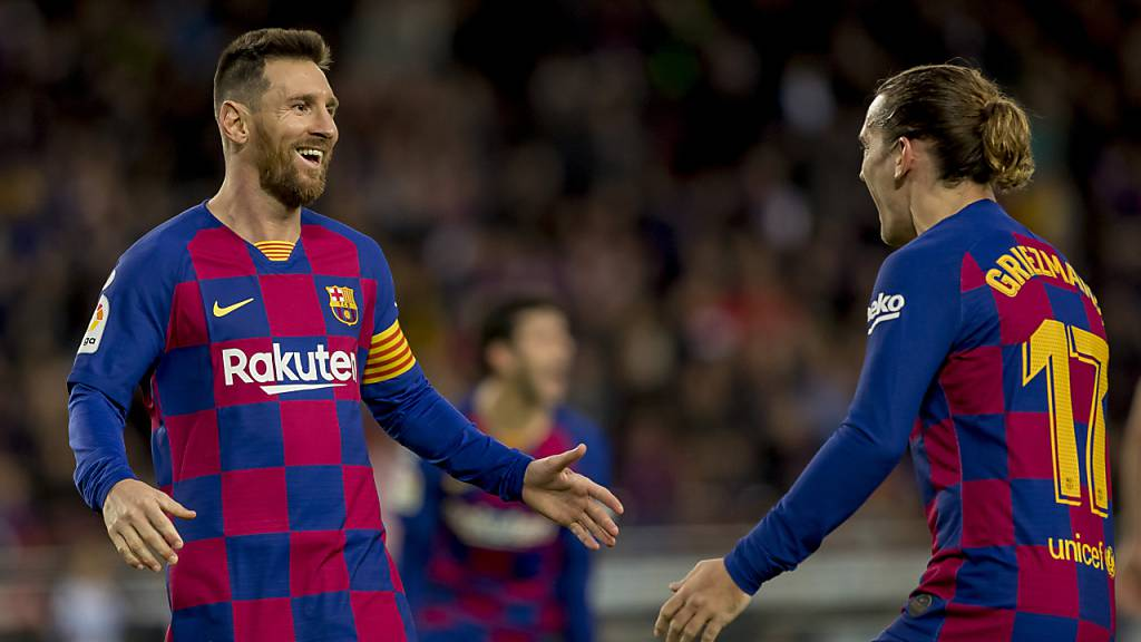 Zwei Torschützen freuen sich: Lionel Messi (links) und Antoine Griezmann