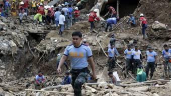 Nach dem Erdrutsch in philippinischen Stadt Itogon, werden immer noch zahlreiche Menschen unter der Schlammlawine vermutet. (Archivbild)