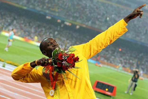 Gold medalist Usain Bolt from Jamaica celebrates during the medal ceremony for the Men's 200m final in the National Stadium at the Beijing 2008 Olympic Games