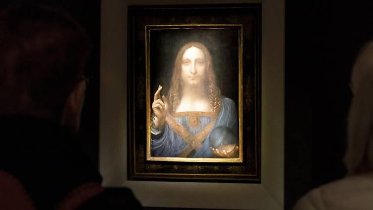 """Das teuerste Kunstwerk der Welt, das Gemälde """"Salvator Mundi"""" von Lenonardo da Vinci, kommt in den neuen Louvre in den Vereinigten Arabischen Emiraten. (Justin Lane / EPA)"""