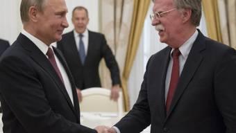 Wladimir Putin und der US-Sicherheitsberater John Bolton am Mittwoch in Moskau.